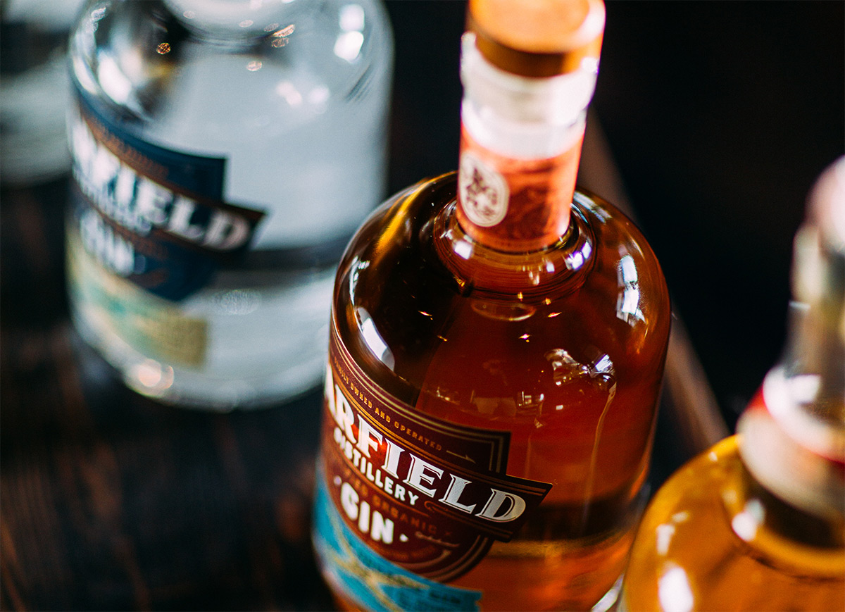 lineup of Warfield spirits focusing on the Barrel Aged Gin