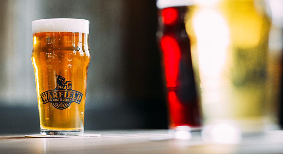 Warfield organic beers with light beer in focus